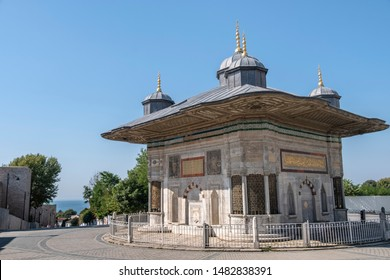 Ancient Ottoman Fountain of Sultan Ahmed II gainst bule sky, in square between Tokapi Palace and Agia Sophia. The most beautiful Turkish Rococo style in Istanbul, Turkey