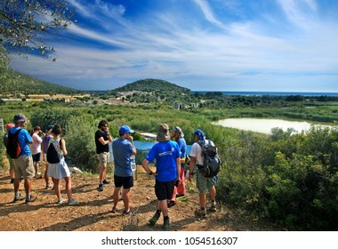 ANCIENT PATARA, ANTALYA PROVINCE, LYCIA, TURKEY- May 11, 2016. Visitors at the archaeological site of Ancient Patara. In the background you can see the ancient theater and the famous beach of Patara.