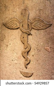 Ancient pharmacy with the symbol of medical caduceus