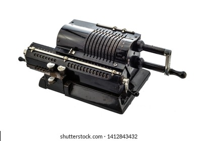 Ancient pinwheel mechanical calculator.The calculating machine, is a mechanical device used to perform automatically the basic operations of arithmetic, rendered obsolete by electronics calculators.