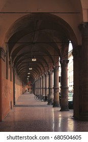 Ancient porticos on the background of Bologna in Italy