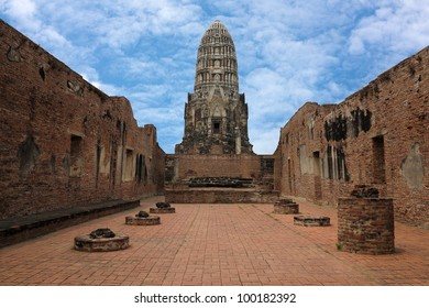 Ancient prang in Ayutthaya of Thailand, with blue sky