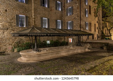 Ancient public wash-house in via Lupo in Bergamo Alta, horizontal night image in the Upper Town