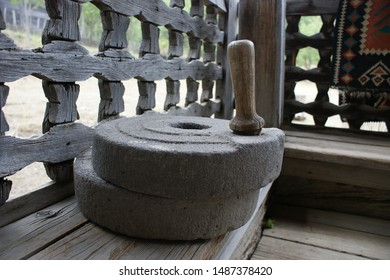 The ancient quern stone hand mill. vintage wheat grain grinder, close-up. Farming and agriculture concept