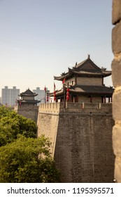 Ancient reconstructed city wall seperating old and modern Xi'an, Shaanxi Providence, China.