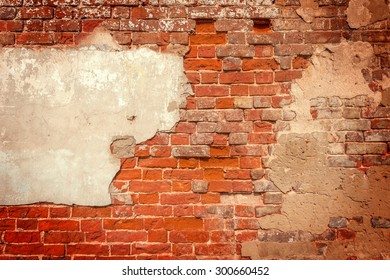 Ancient red brick wall background with cement.