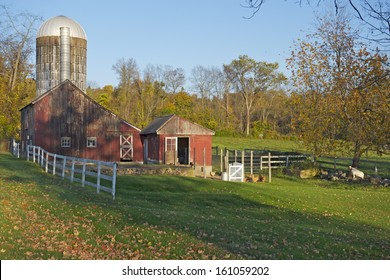 An ancient red farm in Connecticut countryside, South Kent, USA