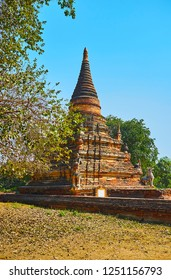 The ancient red stupa of Daw Gyan Pagoda, located in Inwa (Ava) - the former capital of Burmese Kingdom, occupying man made island, Myanmar.