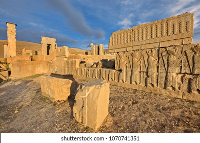 Ancient reliefs in the ruins of the Persian site of Persepolis in Iran, at the sunset.