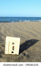 Ancient Retro Musicassette on the Sand near the Water
