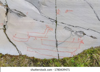 Ancient rock carvings (petroglyphs) in Alta, Norway. Cold summer in Finnmark, Scandinavia.