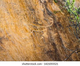 Ancient rock carvings petroglyphs  in Gobustan National park. Exposition of Petroglyphs in Gobustan near Baku, Azerbaijan.