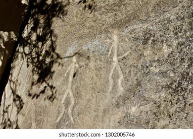 Ancient rock carvings petroglyphs of primitive people in Gobustan National Park near Baku, Azerbaijan