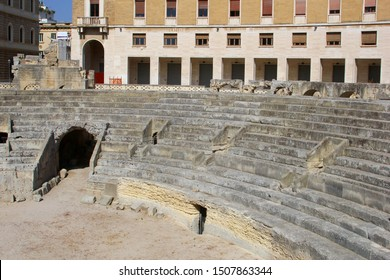 Ancient Roman amphitheatre and old buildings in historic town  and city center of Lecce, Puglia, Italy. The amphitheatre is built in the second century and Lecce is called the Florence of the south