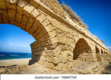 Ancient Roman aqueduct at Caesarea. Israel