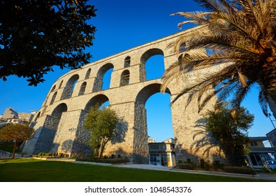 Ancient Roman Aqueduct, Kavala, Greece. View on aqueduct Kamares in the Macedonia, Greece, Europe. Traveling concept background.