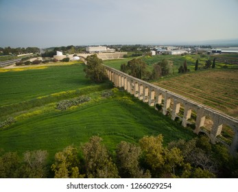 An ancient Roman Aqueduct leading to the Ghetto Fighters' House in Northern Israel.