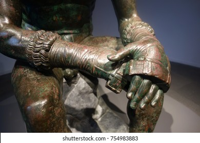 ancient  Roman Boxing gloves, wearing his caestus, a type of leather hand-wrap.