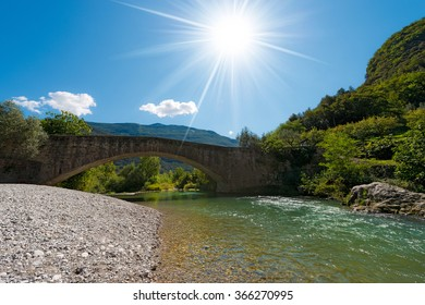 Ancient roman bridge over the Sarca river in the Sarca Valley, Ceniga, Dro, Trentino Alto Adige, Italy, Europe