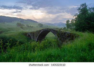 Ancient roman bridge in Zmeitsa villiage in Rhodope mountain covered in fog