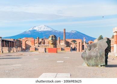 Ancient Roman city of Pompeii against Vesuvius volcano