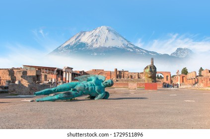 Ancient Roman city of Pompeii on the background Vesuvius volcano