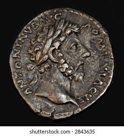 An Ancient Roman Coin With Emperor Antoninus