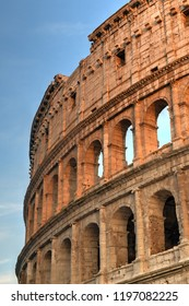 Ancient Roman Colosseum at sunset in Rome, Italy.