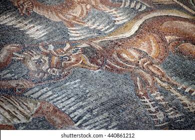 Ancient Roman Empire floor mosaic from The Villa Romana Del Tellaro, Noto (Sicily). Hunting scene. Date: 4th century AD
