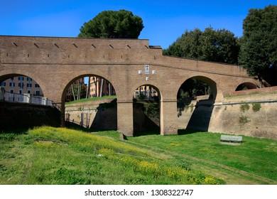 Ancient Roman fortress walls of Rome in sunlight. Historical Italian landmark