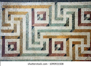 An ancient Roman mosaic art display in colorful pattern, Rome Italy