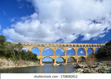 The Ancient Roman Pont du Gard aqueduct and viaduct bridge over the River Gardon, the highest of all ancient roman bridges, near to Nimes in the South of France
