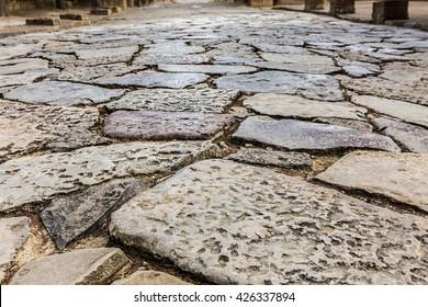 Ancient Roman road in Italica. Street in the Roman ruins of Italica. Santiponce. Sevilla. Spain.