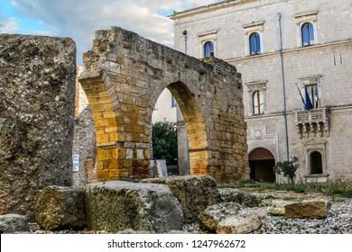 Ancient Roman ruins on Piazza Sotille de Falco outside the archaeological area of San Pietro degli Schiavoni in the Brindisi, Italy