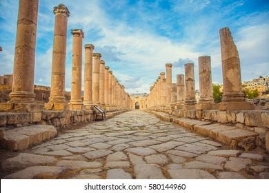 Ancient Roman ruins, walkway along the columns in Jerash, Jordan