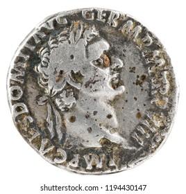 Ancient Roman silver denarius coin of Emperor Domitian. Obverse.