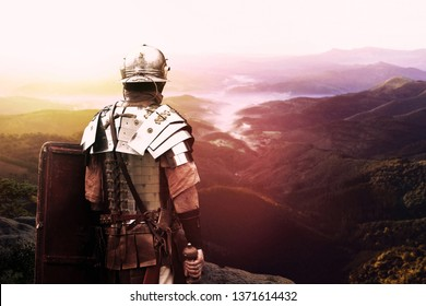 ancient Roman soldier is watching the valley at sunset