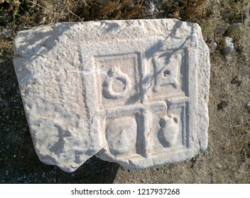 ancient roman stone with signs