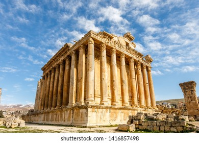 Ancient Roman temple of Bacchus with surrounding ruins and blue sky in the background, Bekaa Valley, Baalbek, Lebanon