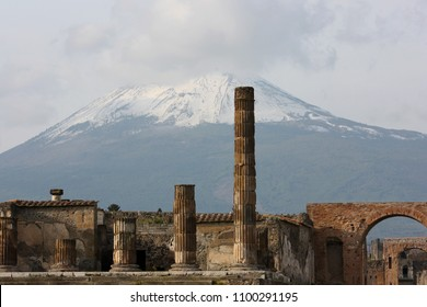 The ancient Roman town-city Pompeii destroyed and buried under volcanic ash and snowy Vesuvius