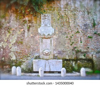 Ancient Roman Water Fountain on brick wall