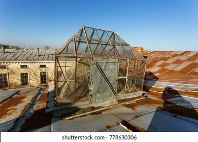 An ancient roof with a corner glass architectural design of a transparent light ceiling. Window glass corner lamp on the roof. Glass roof dome. Window on the roof - a blind lantern of natural light