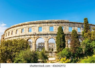 Ancient ruin of Roman Pula arena, daytime, Adriatic sea of Croatia