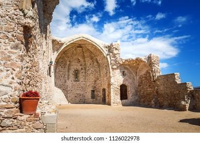 """Ancient ruined church in fortress """"Vila Vella enceinte"""" of Old Town in Tossa de Mar, Costa Brava, Catalonia, Spain."""