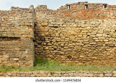 Ancient ruined wall of fortress with loopholes