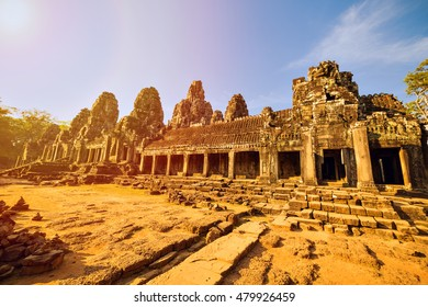 Ancient ruins of Bayon temple with stone faces of king Jayavarman VII , Angkor Wat, Cambodia. Famous travel destinations around the World.