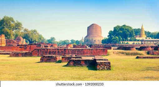 Ancient ruins and buddhist stupa Dharmarajika (Dhamek Stupa) in Sarnath. Uttar Pradesh, India