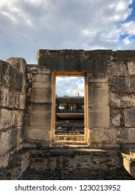 Ancient Ruins - An ancient Doorway and Background View of St. Peter's House at Capernaum on The North Shore of The Sea of Galilee in Israel.