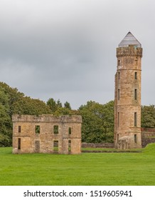 Ancient Ruins at Eglinton Castle  Irvine North Ayrshire Scotland at the start of autumn a popular local attraction in Scotland.