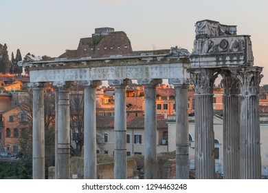 The ancient ruins of the Forum Romanum in Rome, Italy at dusk.